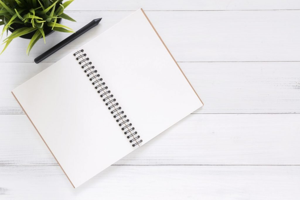 a journal prepped for the plan, update, finalize journaling method for men