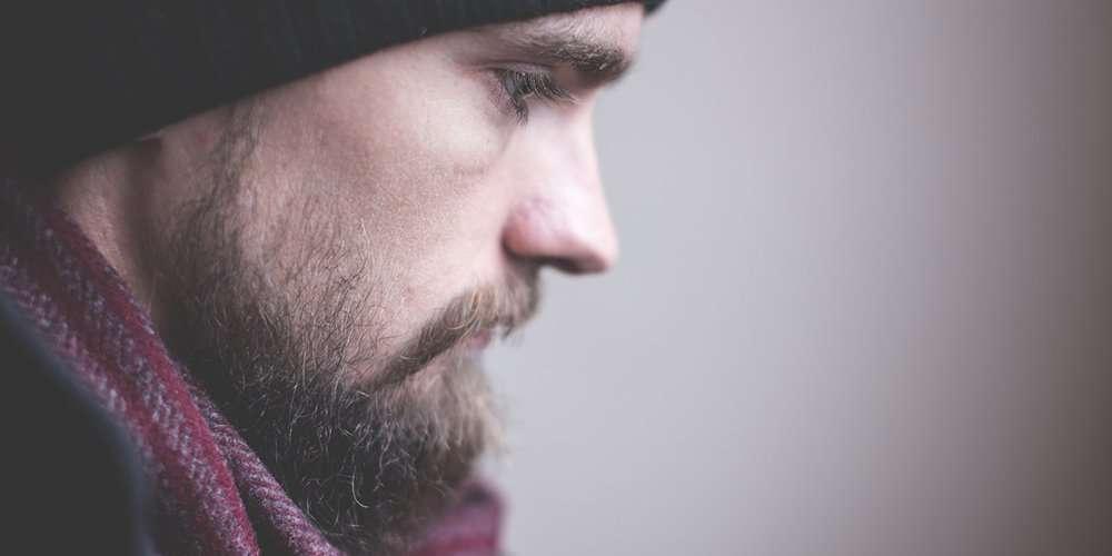 a man with beard pain wondering why does my beard hurt
